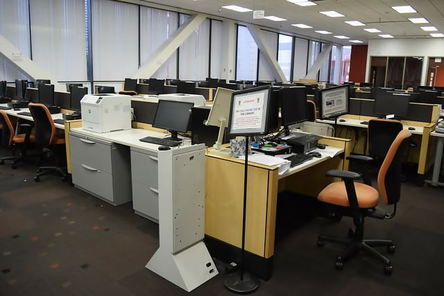 An office with a desk and chair in a roomDescription automatically generated